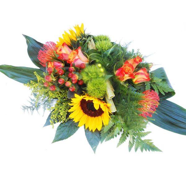 rouw bloemstuk oranje met zonnebloem